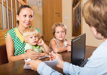 Agent consulting woman with kids