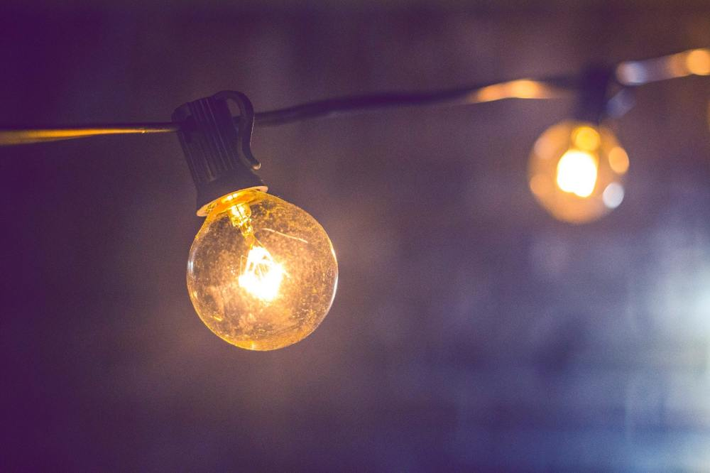 shallow-focus-photography-of-yellow-string-light-185699